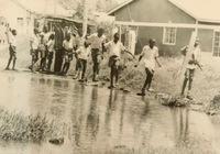 http://localhost/files/_import/Children Crossing Pool of Sewage on Way to School in Migosi Estate, 1996_MS_20180108@The Nation, via Kisumu Museum.jpg